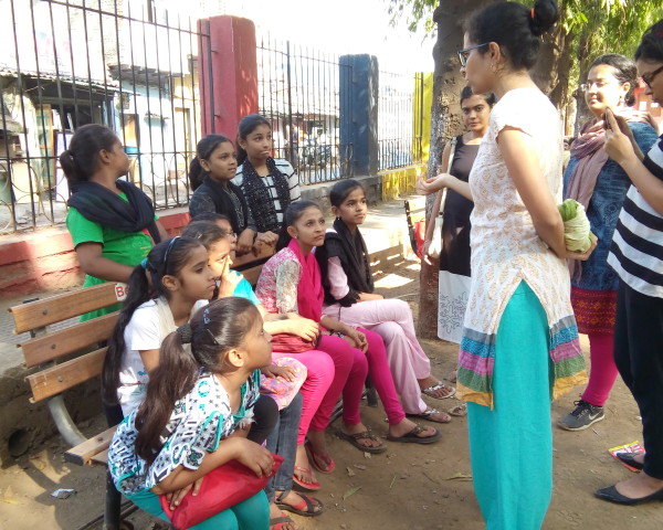 Anu,our Program and Outreach Officer having a discussion with the girls.